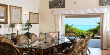 Three Dolphins Villa has a large, indoor dining table that comfortably seats 10 people