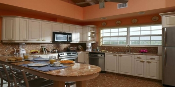 Three Dolphins Villa has a large kitchen and a second kitchen in the main house and 3 further kitchens