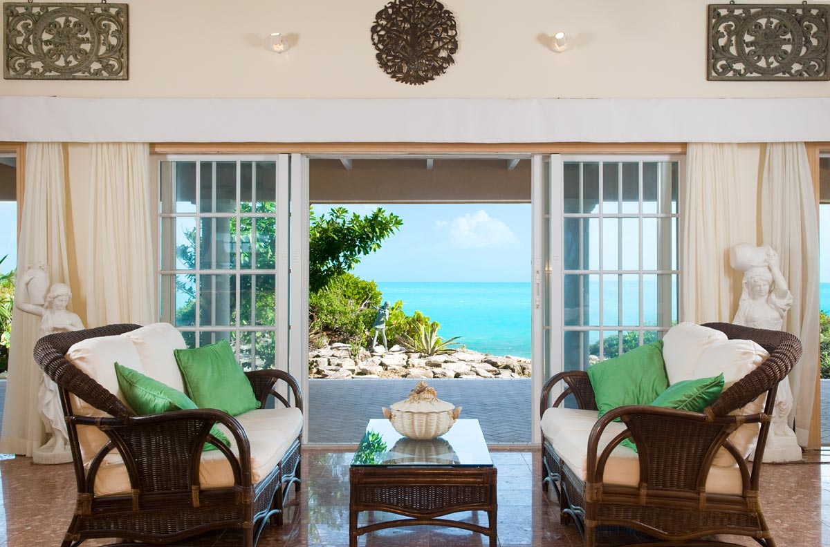 The open plan living area has large French doors and great views of the Caribbean Sea