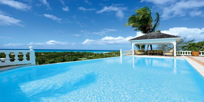 A spacious 4 bedroom colonial-style villa perched above the tranquil waters of Plum Bay with breathtaking panoramas of the Caribbean Sea and the islands of Saba and Anguilla.