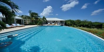 An outstanding hillside villa with 5 equal sized bedrooms and vast heated swimming pool!