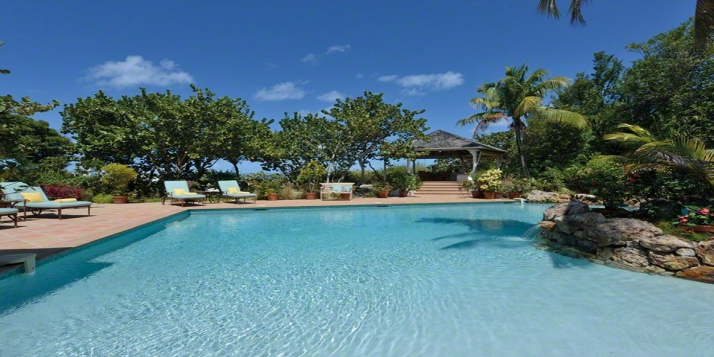 A beautiful 2 bedroom villa with lagoon-style swimming pool located directly on a stunning Caribbean beach!