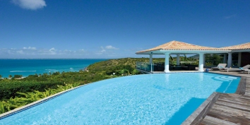A fabulous, fully air conditioned, 4 bedroom villa with swimming pool and unobstructed views of the Caribbean Sea!