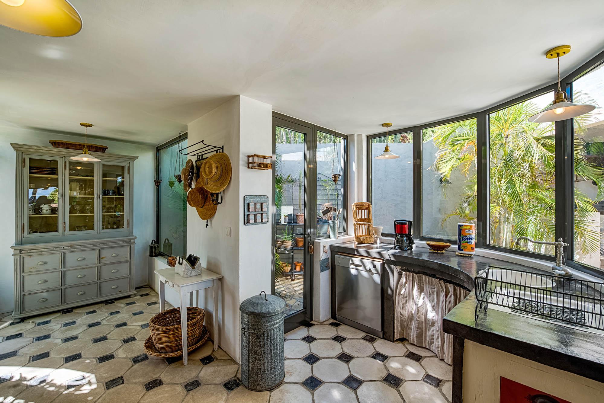 The open and stylish gourmet kitchen at Le Mas des Sables villa rental, Baie aux Cayes, Terres Basses, Saint Martin, Caribbean.