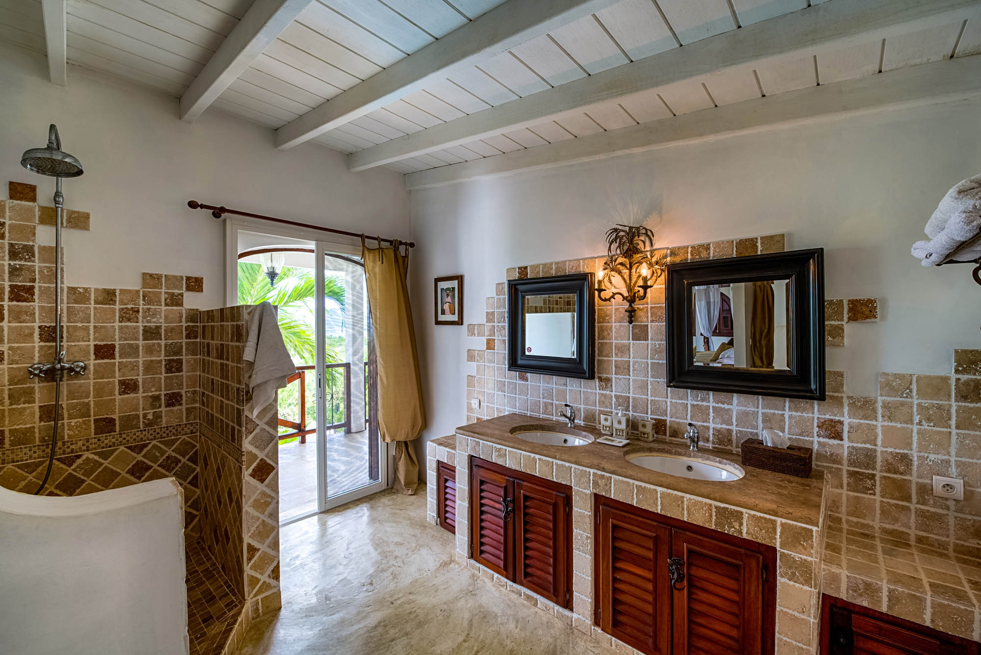 Take a refreshing shower in your private bathroom at Le Mas des Sables, Baie aux Cayes, Terres-Basses, St. Martin villa rental, French West Indies.