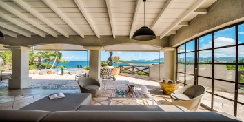 Read a book and take a break at the shaded deck of Le Mas des Sables, Baie aux Cayes, Terres-Basses, St. Martin villa rental, French West Indies.