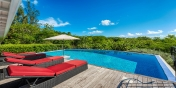 Relax in your comfortable sunbed and experience the ultimate Caribbean feeling at this beautiful St.Martin vacation villa rental.