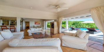 Little Provence, Baie Longue, Terres Basses, has a large open-concept living room connecting the pool deck with sliding doors to let in the refreshing breeze of the Caribbean air.