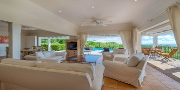 The living room of this Terres-Basses vacation villa rental offers amazing views.