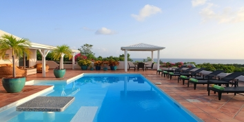 A beautiful 3 bedroom villa on the ridge of a gentle hill, surrounded by tropical gardens and allowing spectacular views south west over the Caribbean Sea and the Island of Saba.