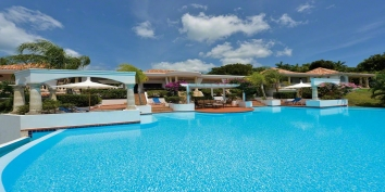 A superb, private villa with 180 degree views of the crystal blue waters of the Caribbean Sea and the setting sun!