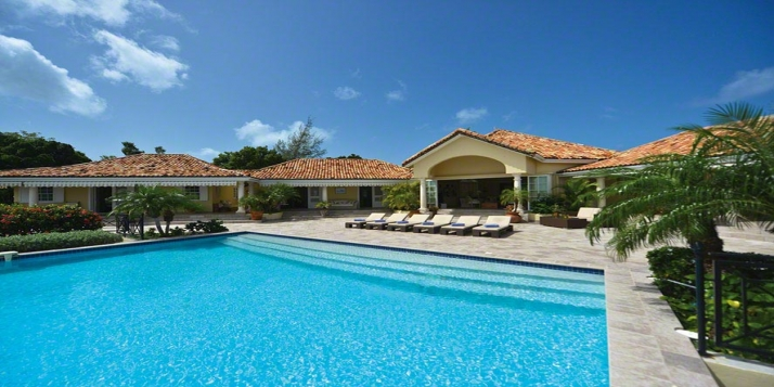 An enchanting neoclassical Caribbean island retreat with 4 bedrooms, heated infinity-edge swimming and fantastic views!