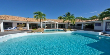 A luxurious 5 bedroom hillside villa with a magnificent pool area offering gorgeous views of the Caribbean Sea and Saba!