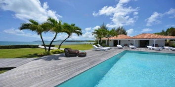 A quintessential 4 bedroom beachfront villa within a perfectly manicured garden oasis with swimming pool and stunning views of the Caribbean Sea!