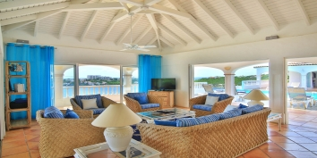 The comfortable and spacious living room of villa Escapade offers panoramic Caribbean views.