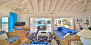 The pool deck is just steps away from the large living room of this beautiful St. Martin villa rental.