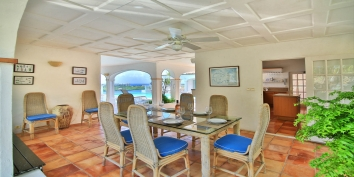 The tastefully decorated indoor dining area of villa Escapade, Terres Basses, St. Martin.
