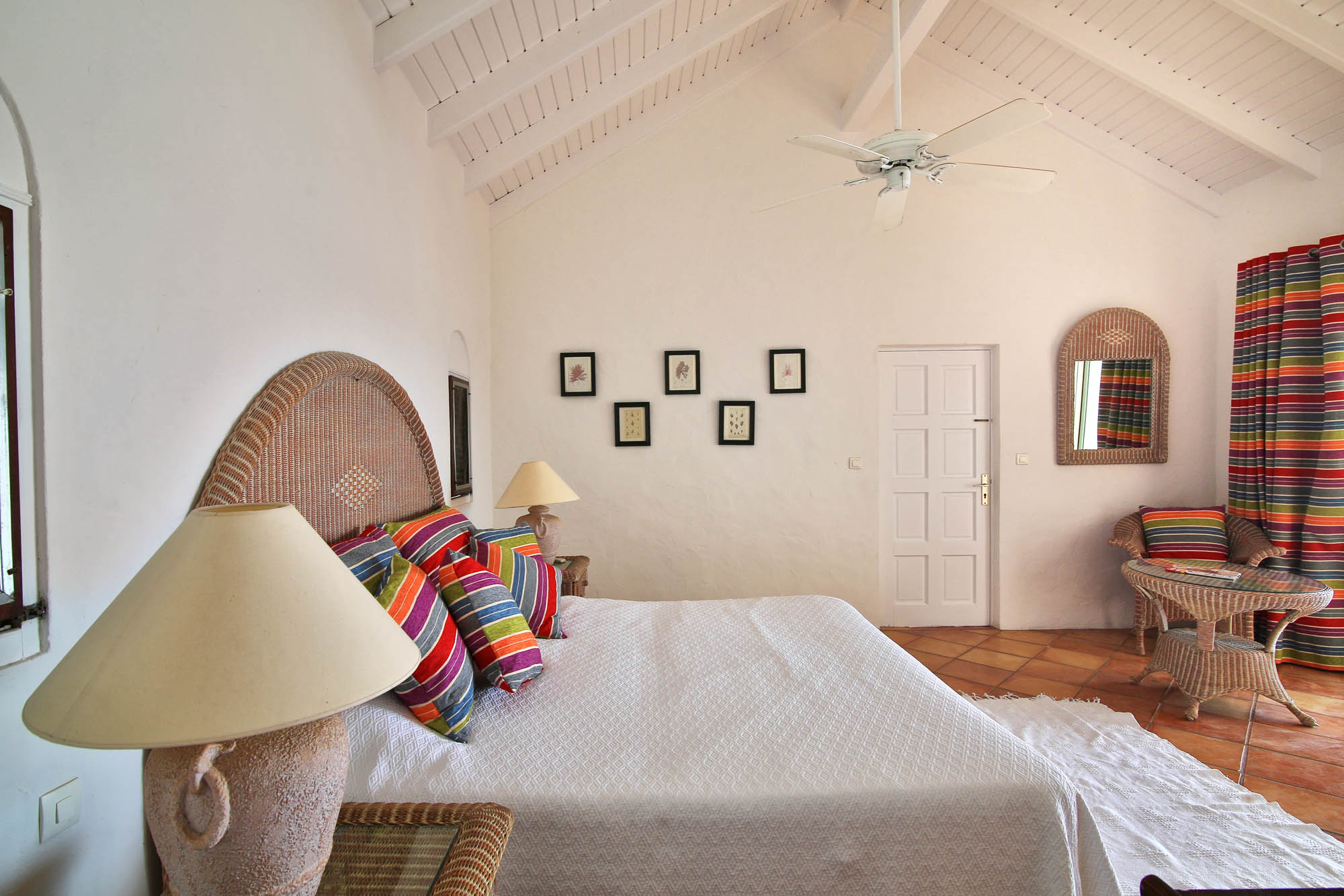 Each bedroom at this Saint Martin holiday rental has a very large private bathroom, air conditioning and ceiling fans.