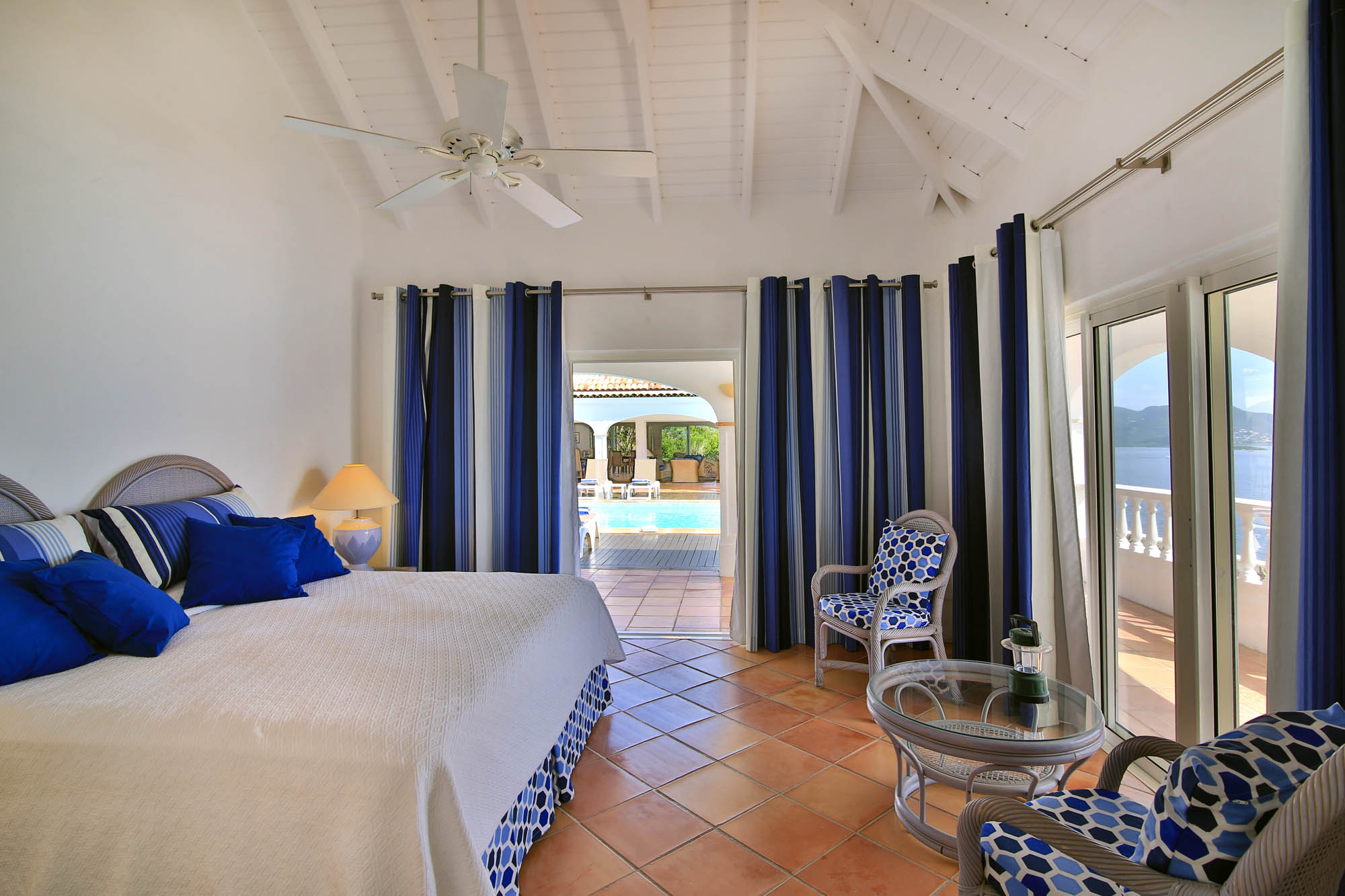 A spacious master bedroom suite with gorgeous ocean views at Escapade, St. Martin villa rental, French West Indies.