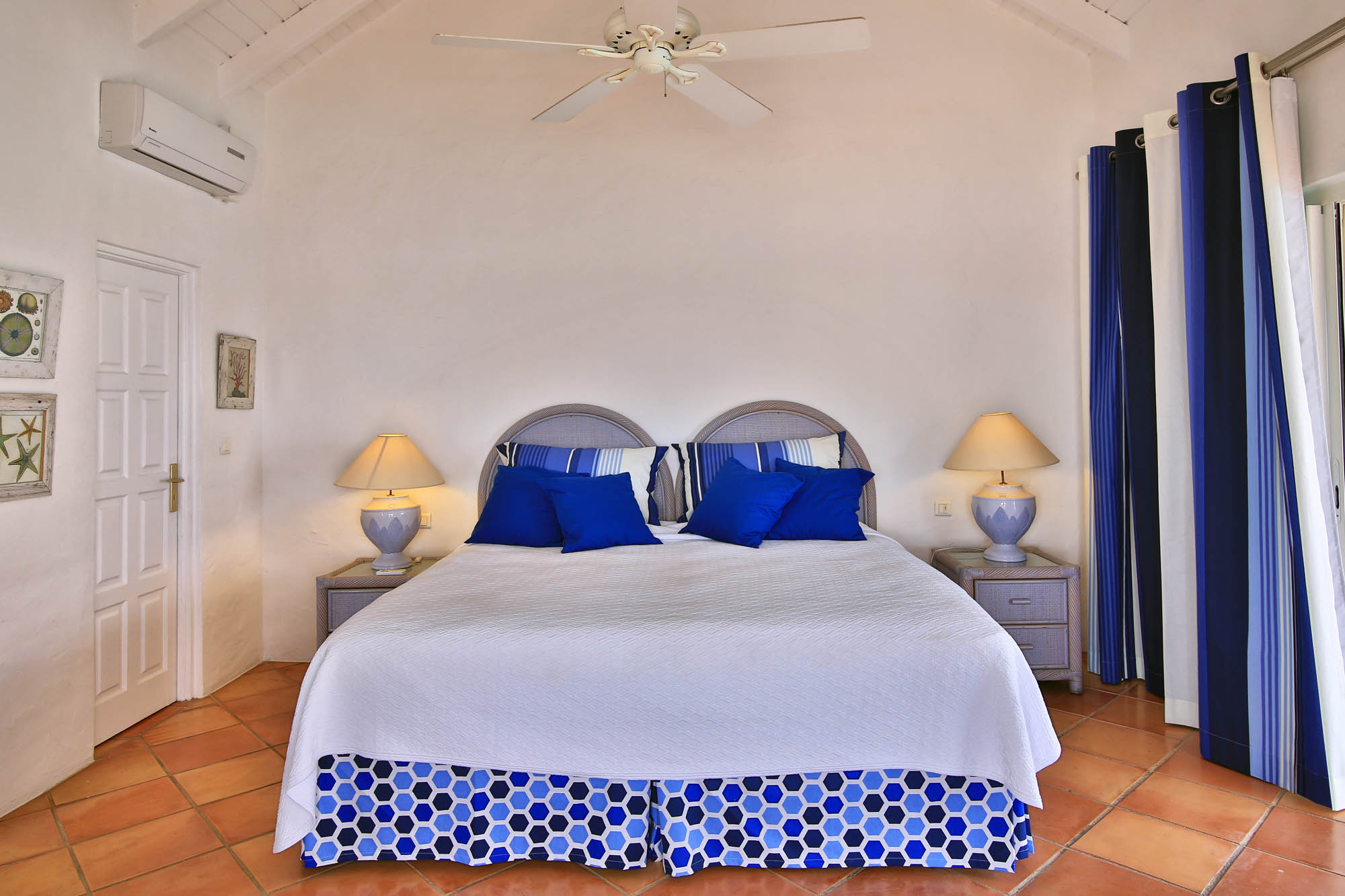 One of the beautifully decorated bedrooms of this Caribbean villa rental.
