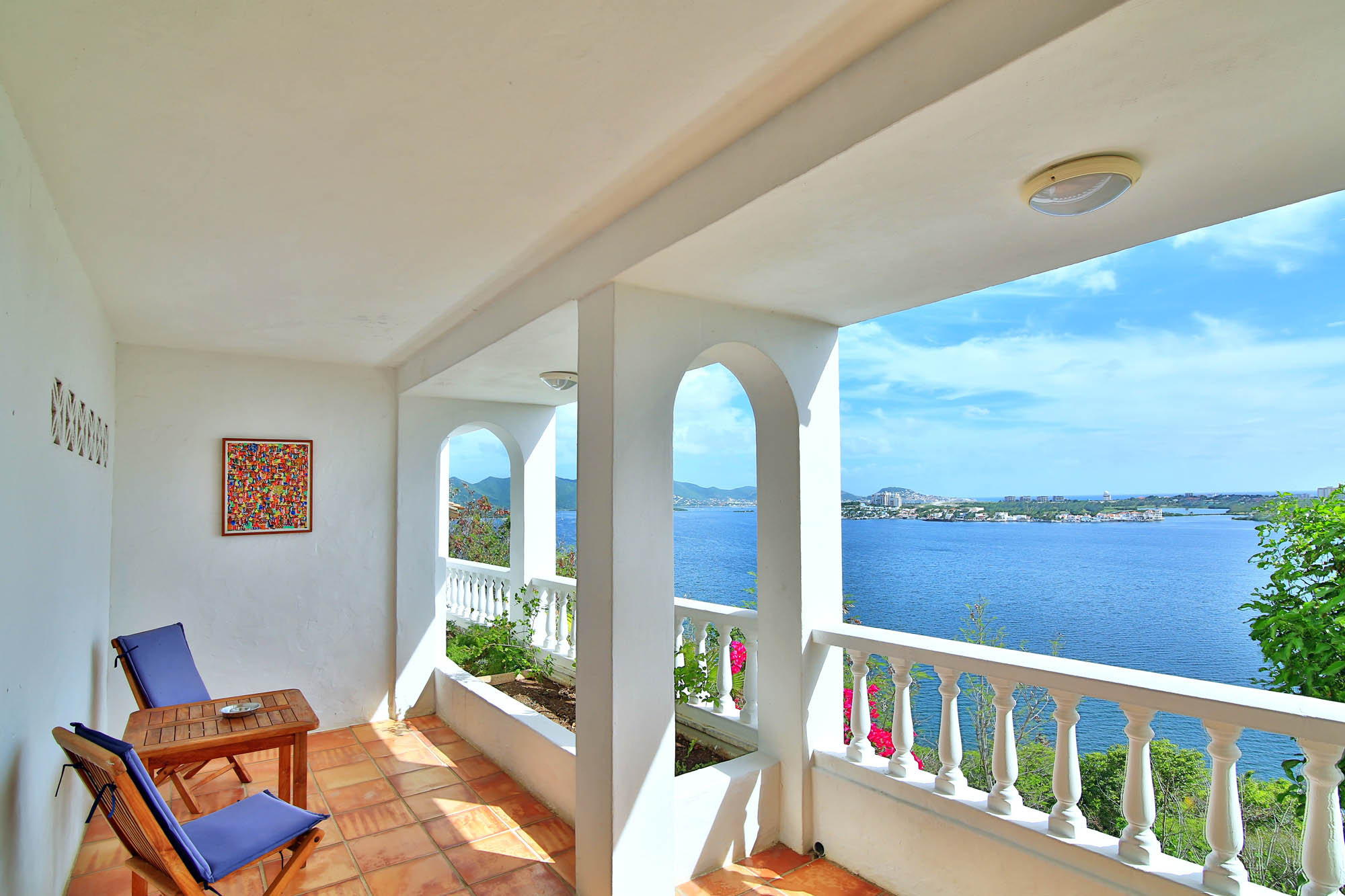 Enjoy stunning ocean views from your private patio at this Terres Basses holiday villa rental in the French West Indies.