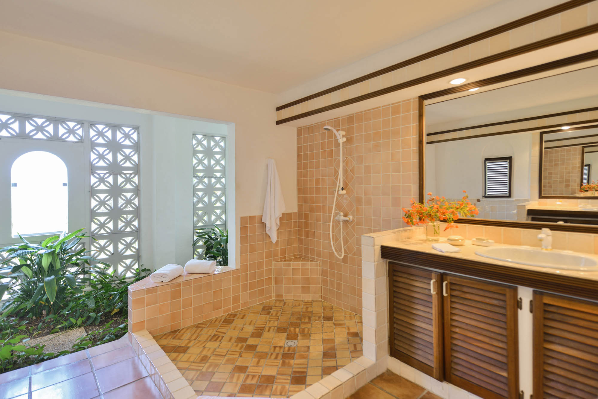 One of the ensuite bathrooms featuring a small garden and walk-in shower.