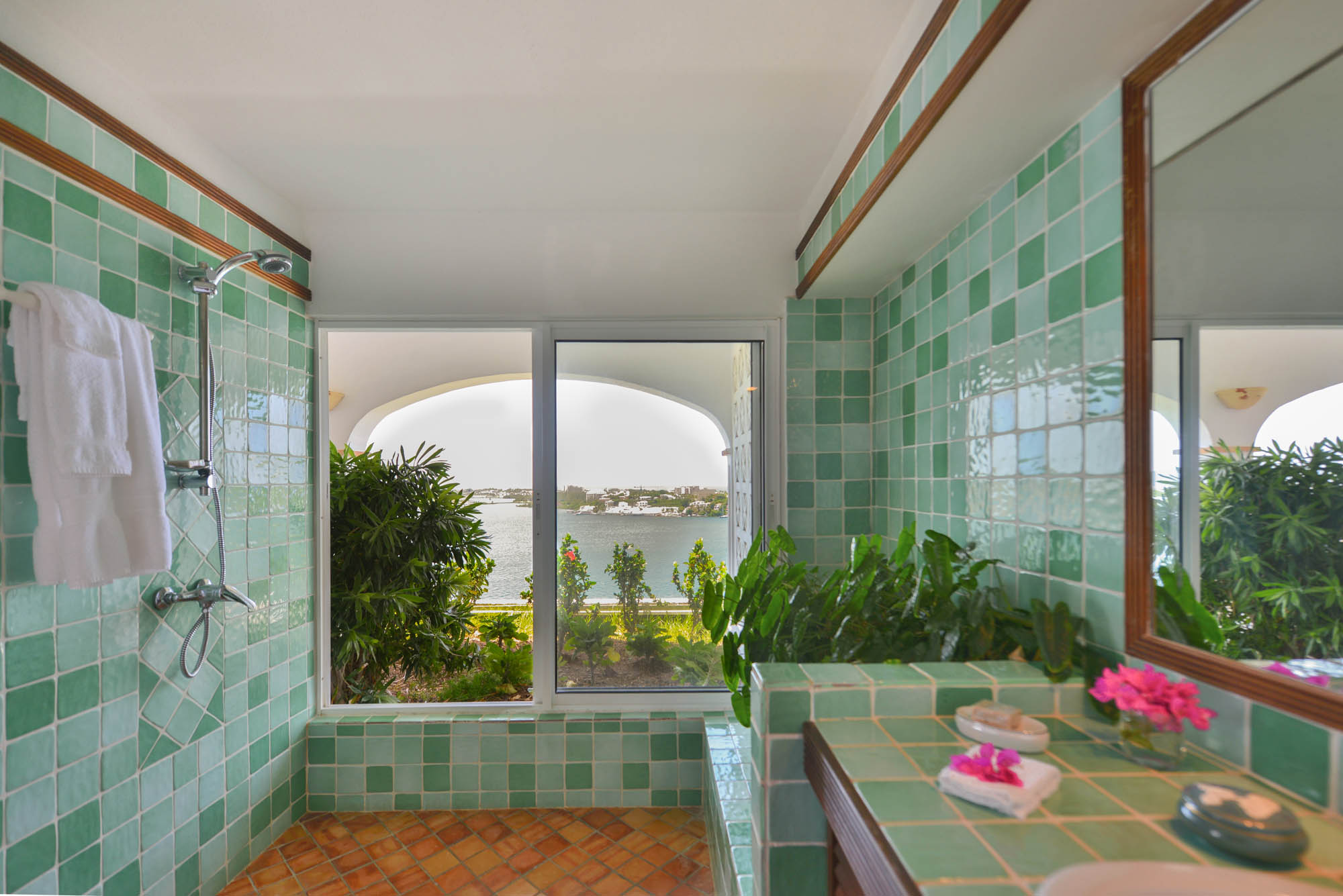 The colourful design and the tropical garden is a perfect combination for a tropical feeling in your private bathroom.