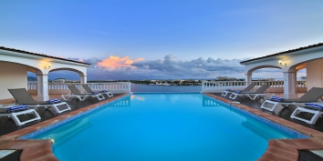 Framed like a painting, this St. Martin holiday villa rental provides amazing views of the sparkling Caribbean Sea and the islands of Saba, St Eustatius and St. Kitts.