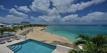 An elegant, fully air-conditioned, 4 bedroom villa, with swimming pool, jacuzzi and beautiful views of the sparkling Caribbean Sea!