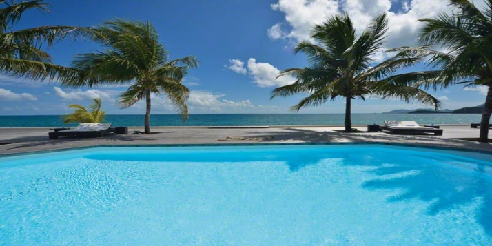 An elegant and spacious 5 bedroom beachfront villa with a swimming pool surrounded by teak deck and beautiful views of Baie Rouge!