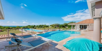 A very private and beautiful villa with 4 bedrooms, 4 bathrooms, 2 swimming pools and views of the Caribbean Sea.