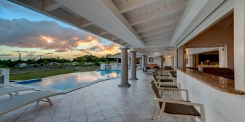 Experience comfortable Caribbean outdoor living and fall in love with beautiful sunsets at this St. Martin villa rental, French West Indies.