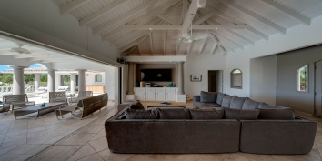 La Bastide villa rental offers a great room with stylish décor, ceiling fans and a big flat screen TV with DVD, Stereo Tape/CD.