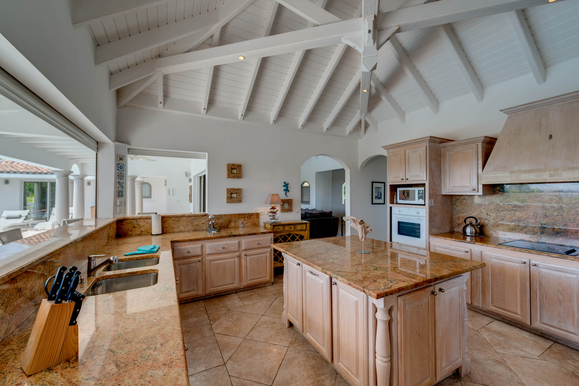 The elegant and fully equipped kitchen with everything you may need while on vacation in the French West Indies.