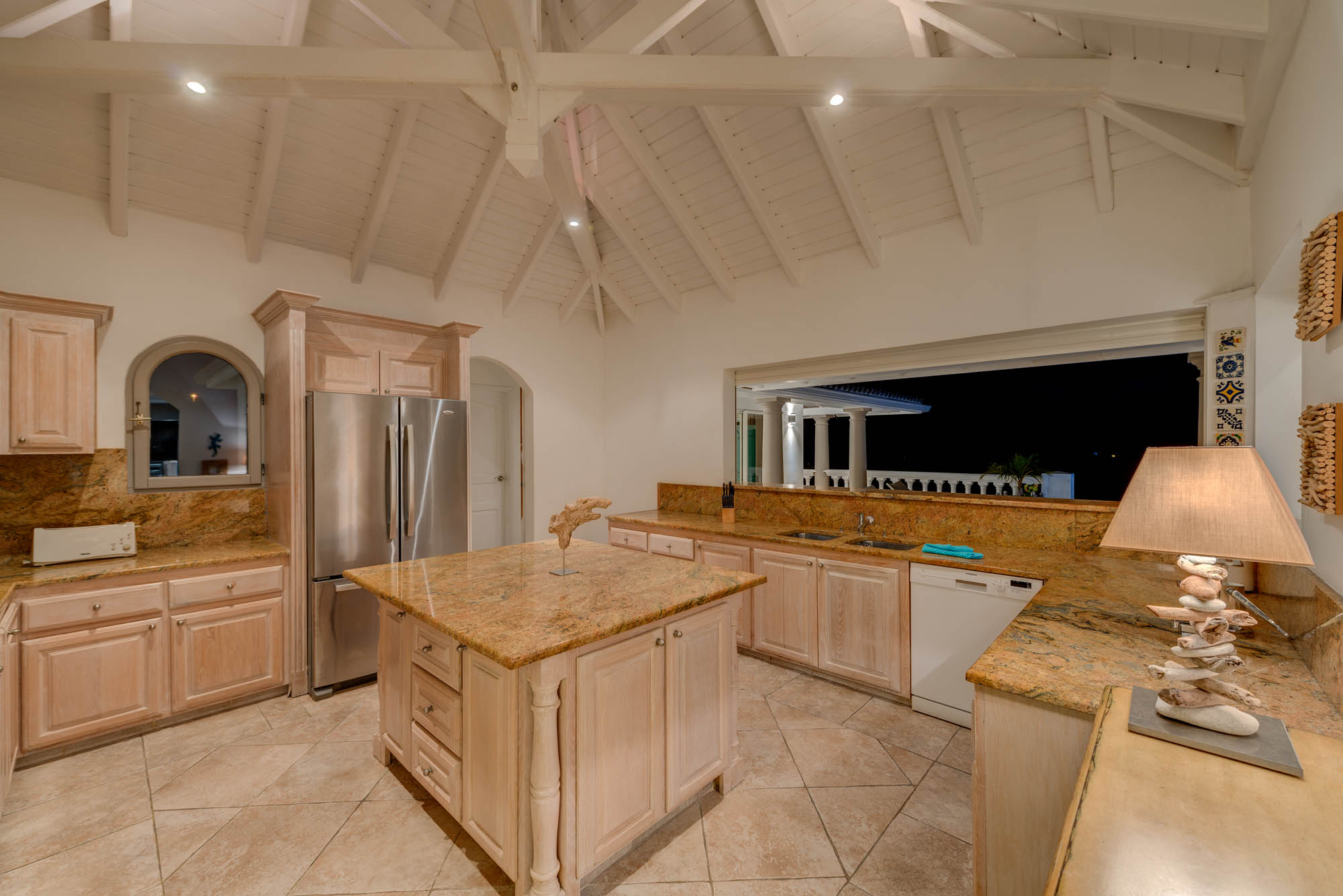 Prepare casual and delicious meals in the fully equipped kitchen of this Caribbean holiday villa.