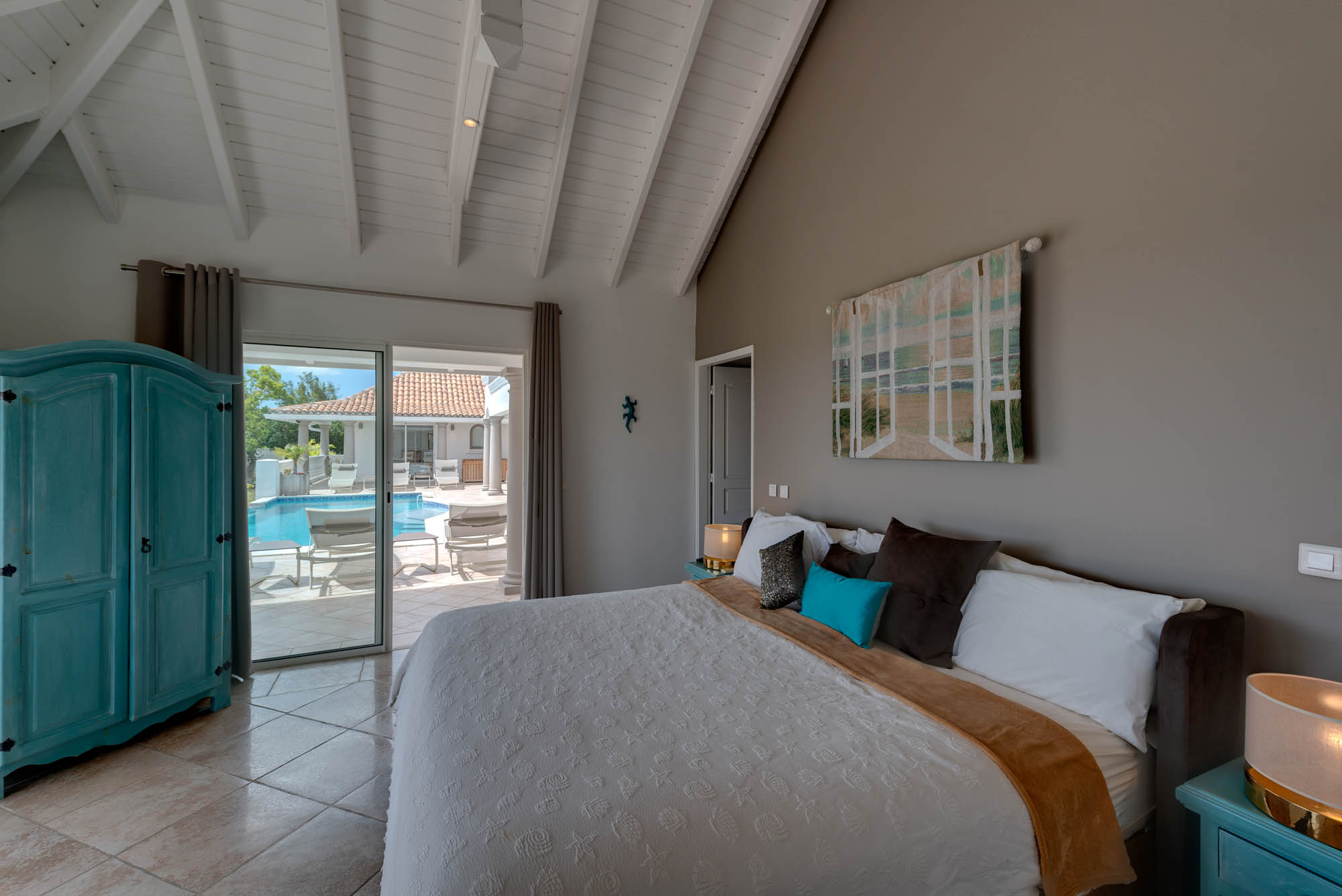 This Caribbean holiday villa has four bedroom with king-size beds and private bathrooms.