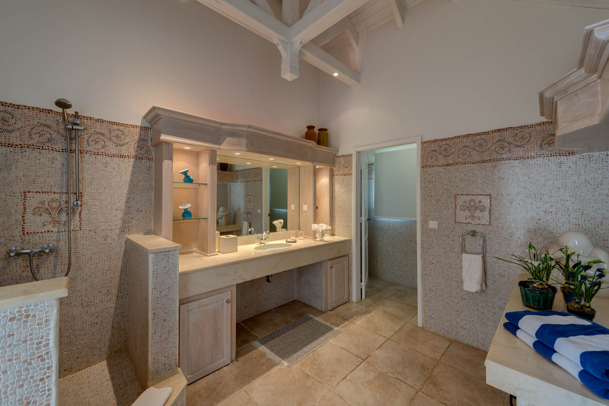 The ensuite bathrooms of the master bedrooms have an elegant mosaic tiled design.