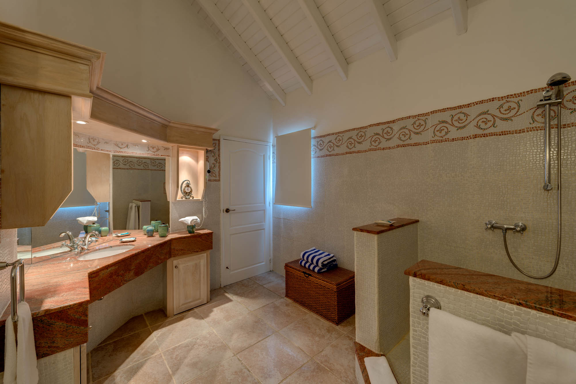 The bathrooms of La Bastide, Baie Longue, Terres Basses, are contemporary with an elegant ambience.