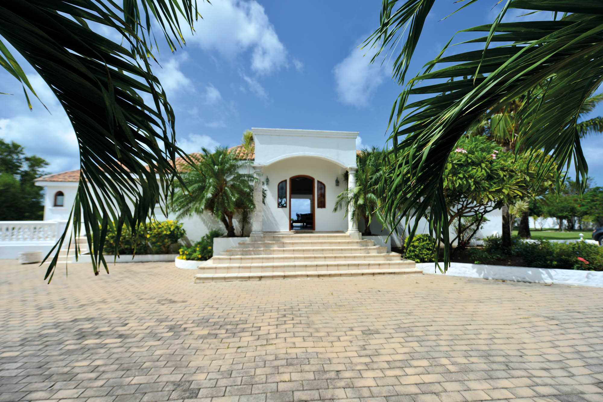 This beautiful villa rental in Terre-Basses, Saint Martin is accessible through an electric iron gate and a paved drive-way.