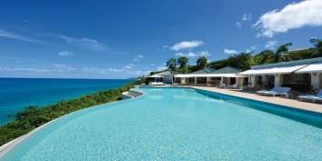 A beautiful, oceanfront villa set in 2.5 acres of lush landscaped gardens with 5 bedrooms, heated swimming pool, gym and stunning views of the sparkling Caribbean Sea!