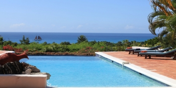A luxurious, 4 bedroom, French West Indies villa with a very large overflow pool of 20 x 40 overlooking the sparkling Caribbean Sea!
