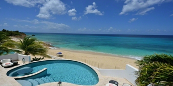 An elegant, fully air-conditioned, beachfront villa with 3 bedrooms, swimming pool and gorgeous views of the sparkling Carribean Sea!