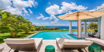 An absolutely magnificent, exclusive, beachfront villa with 4 bedrooms, exquisite interiors, swimming pool and breathtaking views of Baie Longue.