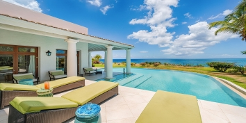 A luxurious, spacious and very exclusive 4 bedroom, 4 bathroom oceanfront villa with magnificent swimming pool and views of the Caribbean Sea!