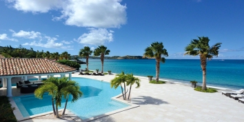 An absolutely gorgeous, spacious, 5 bedroom, 5 bathroom beachfront villa with huge swimming pool and stunning Caribbean sunsets!