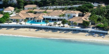 A luxurious, spacious, 6 bedroom, 6 bathroom, beachfront villa with huge swimming pool and stunning Caribbean sunsets!