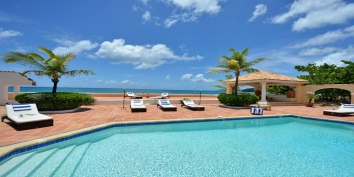 A beautiful, beachfront villa with 4 bedrooms, 4 bathrooms, swimming pool and stunning views of Baie Rouge Beach and the Caribbean Sea!
