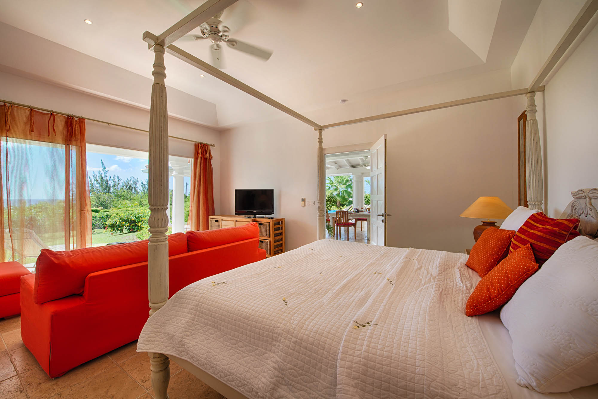 The new master bedroom at this Terres-Basses vacation villa rental opens the gazebo and to a private terrace.