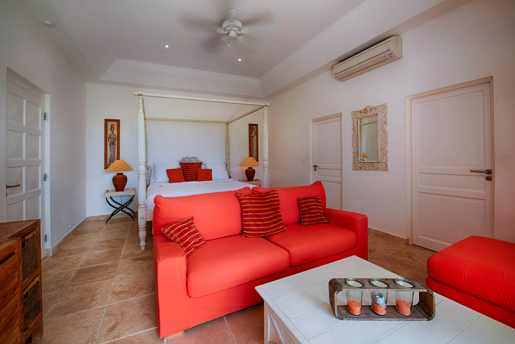 Each bedroom of Lune de Miel villa rental has a king size bed, air conditioning, TV and ceiling fan.