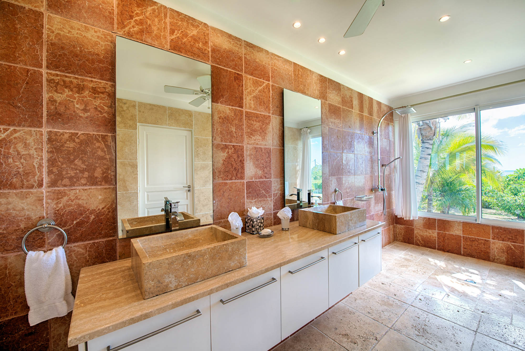 Luxury and elegant ambience making the bathroom of Lune de Miel villa rental, Baie Longue, Terres-Basses a highlight.